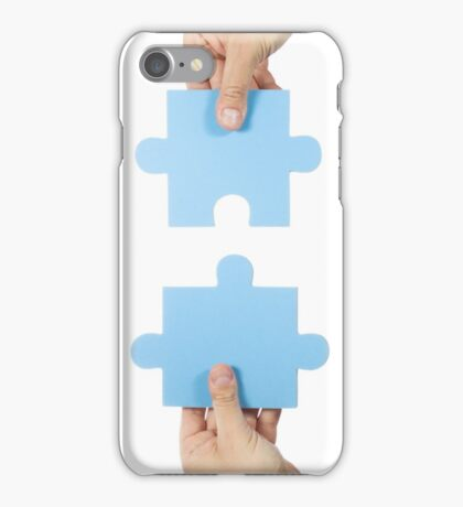 Two hands connecting puzzle pieces iPhone Case/Skin