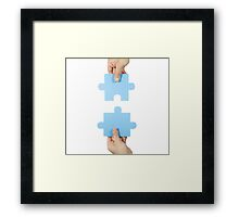 Two hands connecting puzzle pieces Framed Print