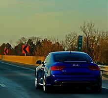 Blue Audi R5 On Highway by mckinnonphoto