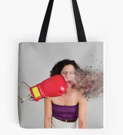 Mechanical boxing devices punches a young woman in the face Tote Bag