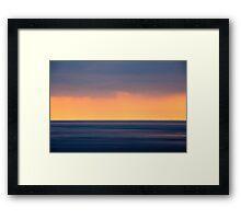 Sunset over ocean Framed Print