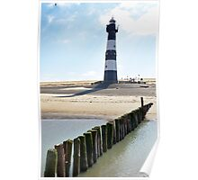Lighthouse on a beach in Holland Poster