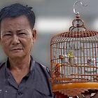 Beijing Bird Vendor by phil decocco
