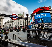 Piccadilly Circus during the day with tourist near the tube by Mattia  Bicchi Photography