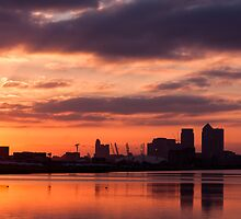 Canary Wharf and O2 Arena Sunset with reflection in the water by Mattia  Bicchi Photography