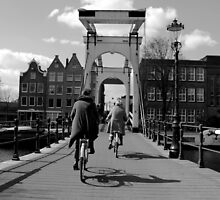 Amsterdam - Cycling over a Bridge by rsangsterkelly