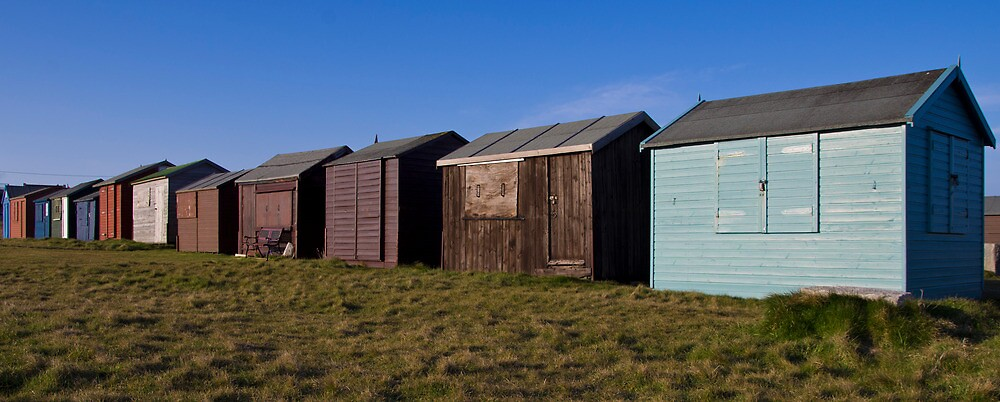 Beach huts at Portland Bill, Dorset by Lugburtz