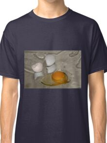 Raw egg and broken egg shell Classic T-Shirt