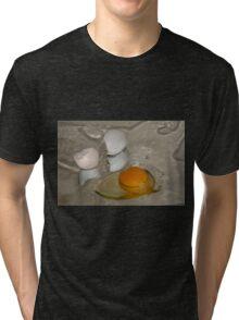Raw egg and broken egg shell Tri-blend T-Shirt