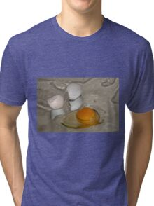Raw egg and broken egg shell Tri-blend T-Shirt