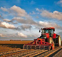 Planting potatoes by Adri  Padmos