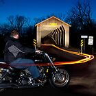 Motorcycle Crossing Covered Bridge by Mark Van Scyoc
