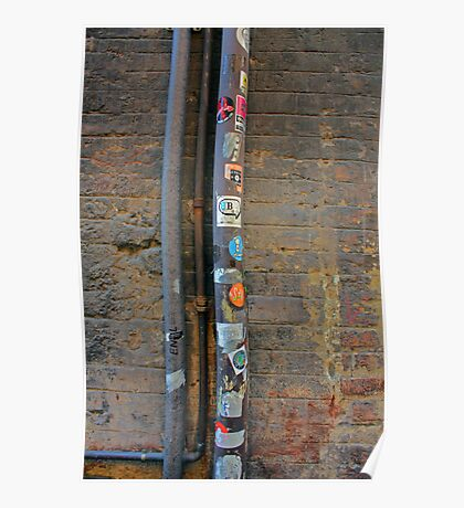 Sticker-covered Drainpipe in Siena, Italy Poster
