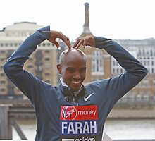 Mo Farah doing the Mobolt by Tower Bridge ahead of the Virgin London Marathon 2013 by Keith Larby