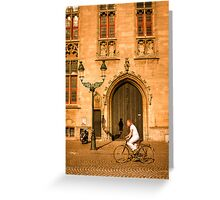 A local rides his bike in the square in Bruges Greeting Card