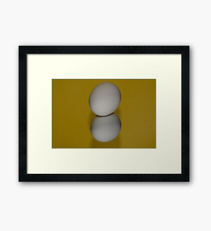 One egg and reflection Framed Print