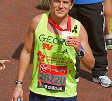 George Rainsford poses with his medal after finishing the London Marathon by Keith Larby