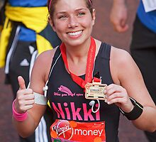 Nikki Sanderson after finishing the London Marathon by Keith Larby