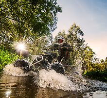 Quad rider through water stream by homydesign