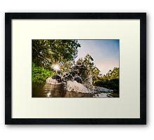 Quad rider through water stream Framed Print
