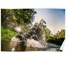 Quad rider through water stream Poster
