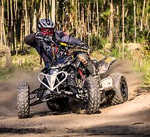 ATV racer takes a turn during a race.  by homydesign