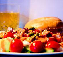 Smoked salmon bagel with salad by Andrew Robinson
