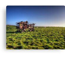 decaying farm machinery on Alderney Canvas Print