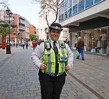 Police Lady poses in Gibraltar High Street  by Keith Larby
