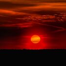 Big Sun Setting. Orange Sky And Dramatic Sunbeams by GrishkaBruev