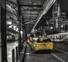 Yellow taxis at Flinders Street station, Melbourne by ajhaysom