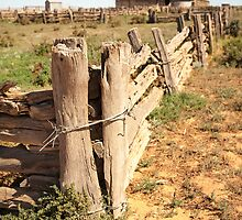Rough old wooden fence in the outback by Jess Gibbs