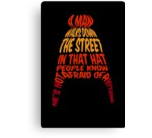 A man walks down the street... Canvas Print