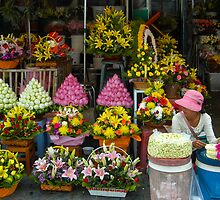 Cambodian Flower Seller by mlphoto