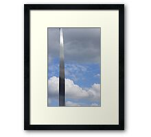 A silver sliver through the clouds Framed Print
