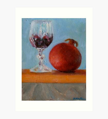 pomegranate and glass of red wine on a book Art Print