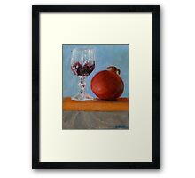 pomegranate and glass of red wine on a book Framed Print