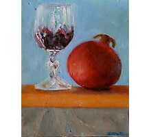 pomegranate and glass of red wine on a book Photographic Print