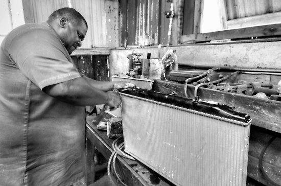 Zeno working at the welding workshop... by Jeremy Lavender Photography