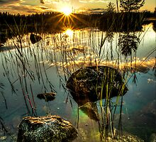 Sunset by a small lake by Stefan Johansson