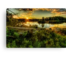 Small boat in the sunset Canvas Print