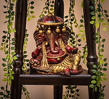 Colorful clay idol of Indian God Ganesha in a resting pose by Prashant Agrawal