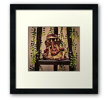 Colorful clay idol of Indian God Ganesha in a resting pose Framed Print