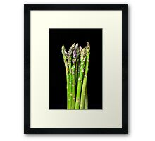 Green asparagus on black Framed Print