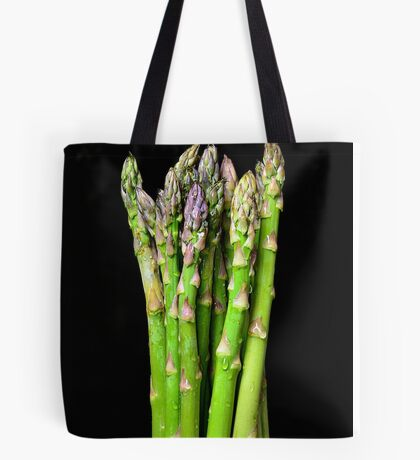 Green asparagus on black Tote Bag