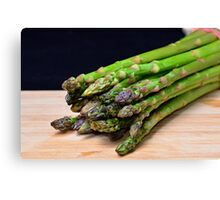 Green asparagus on wood  Canvas Print