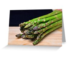 Green asparagus on wood  Greeting Card