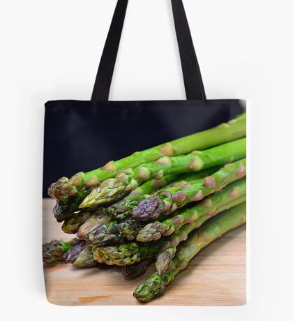Green asparagus on wood  Tote Bag