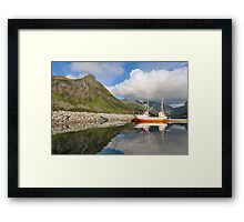 Small fishing boat in the harbor of the fjord Framed Print