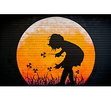 Graffiti of a little girl picking up radiation Photographic Print